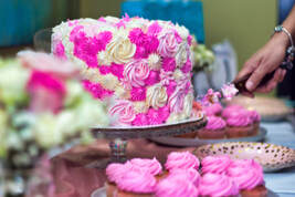 Picture of beautiful Sweet sixteen pink and white cake being cut before being served at a birthday party in Hialeah